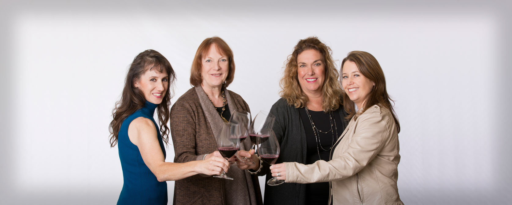 Four founders with wine glasses
