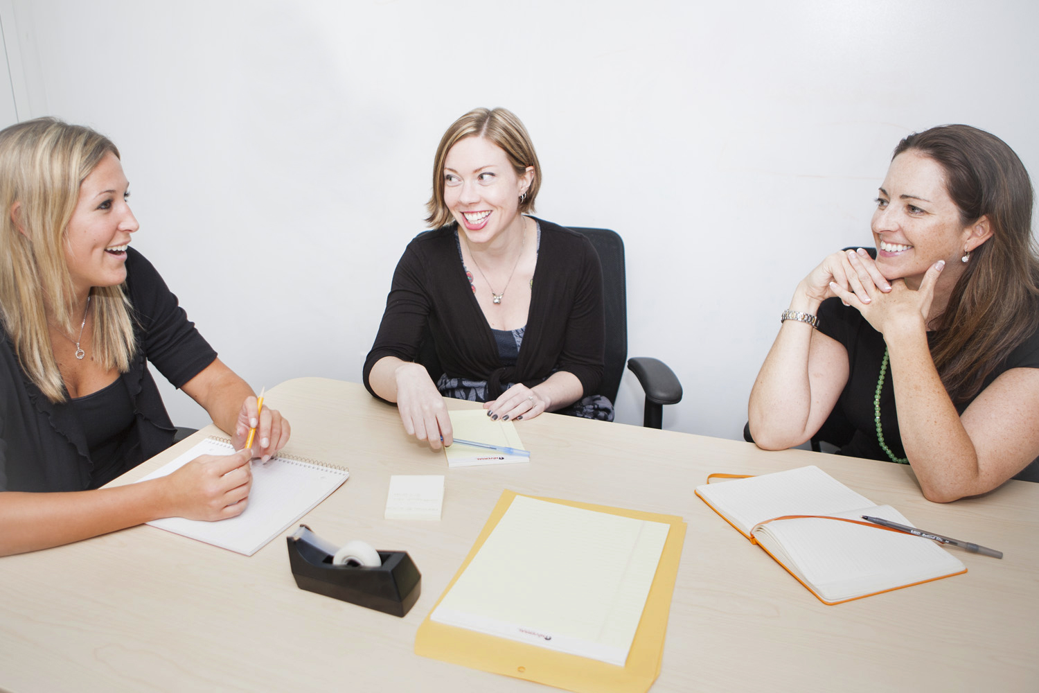 3 Women in business meeting at table