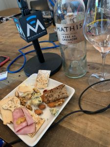 Food tray with bottle of Mathis Rose de Grenache