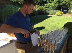 DeLoach - Launch Celebration pouring bubbles
